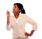 Ethnic businesswoman looking and pointing up