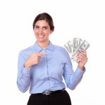 Fashionable young woman pointing to money