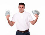 Friendly man standing and holding cash
