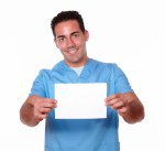 Handsome nurse guy holding a white card