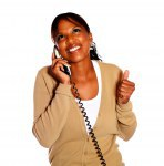 Happy afro-american woman speaking on phone