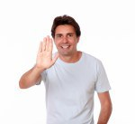 Hispanic male gesturing stop with hand