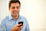 Hispanic man texting with his cellphone