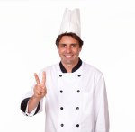 Latin male chef gesturing victory with fingers
