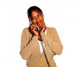 Lovely afro-american woman speaking on phone