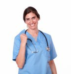 Lovely female nurse smiling with winning sign