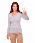 Lovely woman gesturing victory sign with fingers