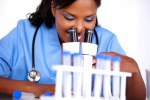 Medical doctor female working with a microscope