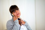 Pensive young woman speaking on phone copyspace