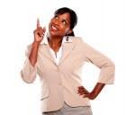 Pretty businesswoman pointing up