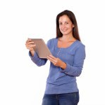 Pretty female working on tablet pc while standing
