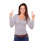 Pretty girl showing victory sign with her fingers
