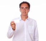 Senior person holding a blank business card