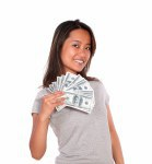 Smiling asiatic young woman holding cash money