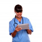 Smiling professional nurse using her tablet pc
