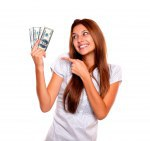 Smiling woman looking and pointing cash money
