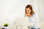 Smiling woman using on laptop