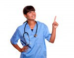 Smiling young nurse looking and pointing up