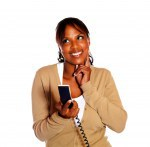 Smiling young woman holding phone handset
