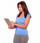 Sporty mature woman using her tablet pc