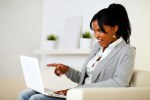 Surprised woman pointing to laptop screen