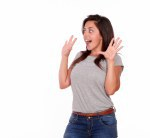 Surprised young woman screaming with hands up