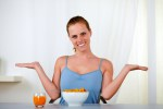 Young lovely woman eating healthy breakfast
