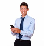 Young male businessman texting on his cellphone