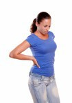 Young woman standing with back pain
