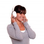 Young woman with headphone listening music