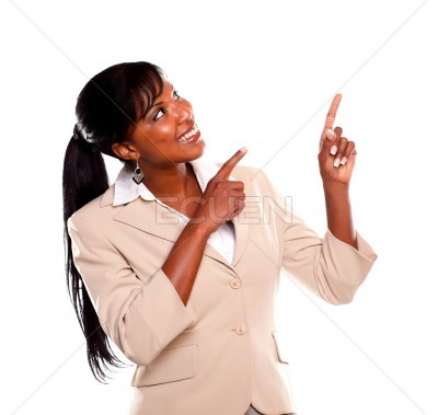 Adult businesswoman looking and pointing up