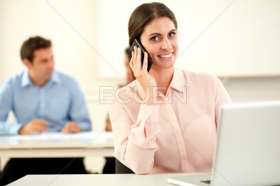 Adult businesswoman smiling at you while talking