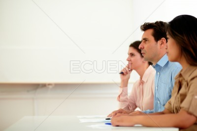 Adult employee team listening to a seminar
