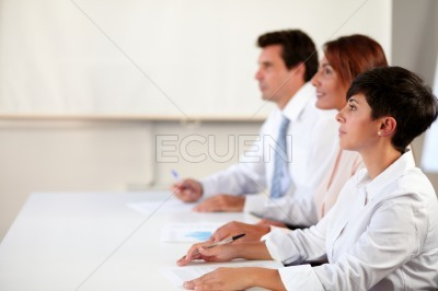 Adult executive group listening to a conference