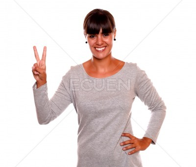 Adult girl holding up two fingers in victory sign