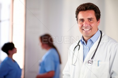 Adult hispanic doctor on white coat standing