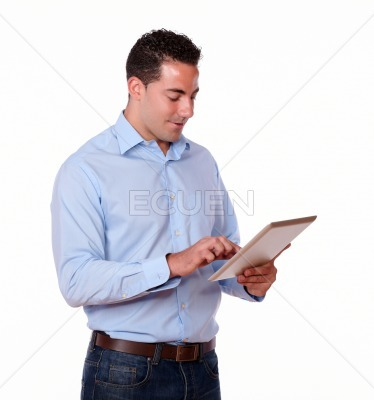 Adult male looking at his tablet pc