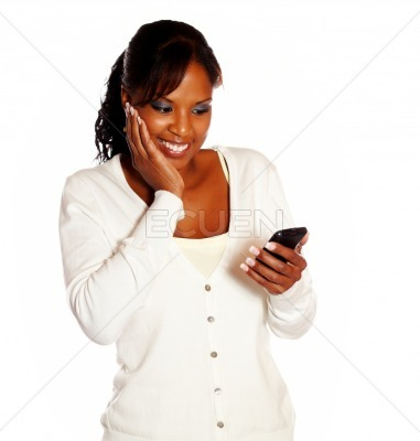 Adult woman reading message on mobile phone