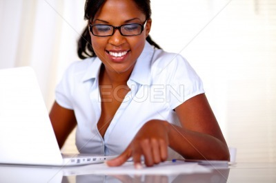 Afro-american girl with black glasses studying