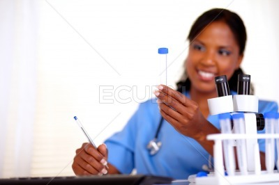 Afro-american nurse looking to test tube