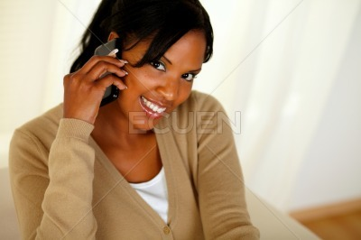 Afro-american woman conversing on mobile phone