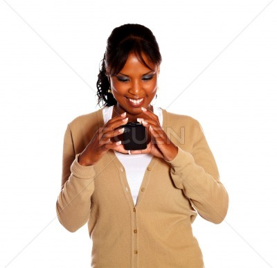 Afro-american woman reading message on cellphone