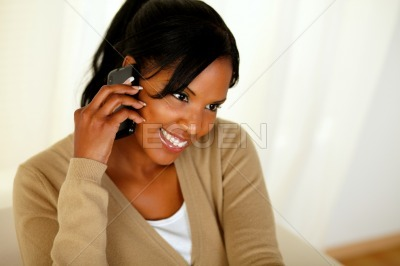 Afro-american woman speaking on mobile phone