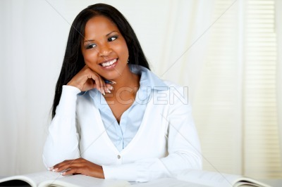 Afro-american young black girl studying