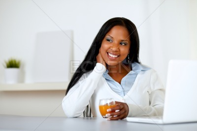 Afro-american young woman with an orange juice