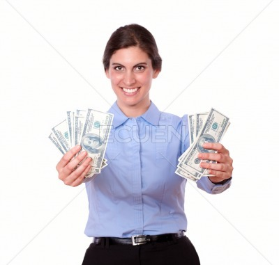 Ambitious young woman holding cash dollars