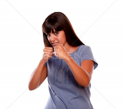 Angry latin young female with clenched fists