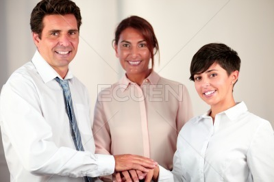 Attractive business people with unity symbol