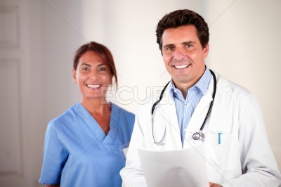Attractive doctor and nurse smiling at you