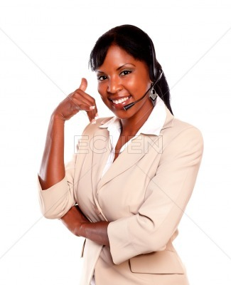 Attractive ethnic receptionist wearing headset